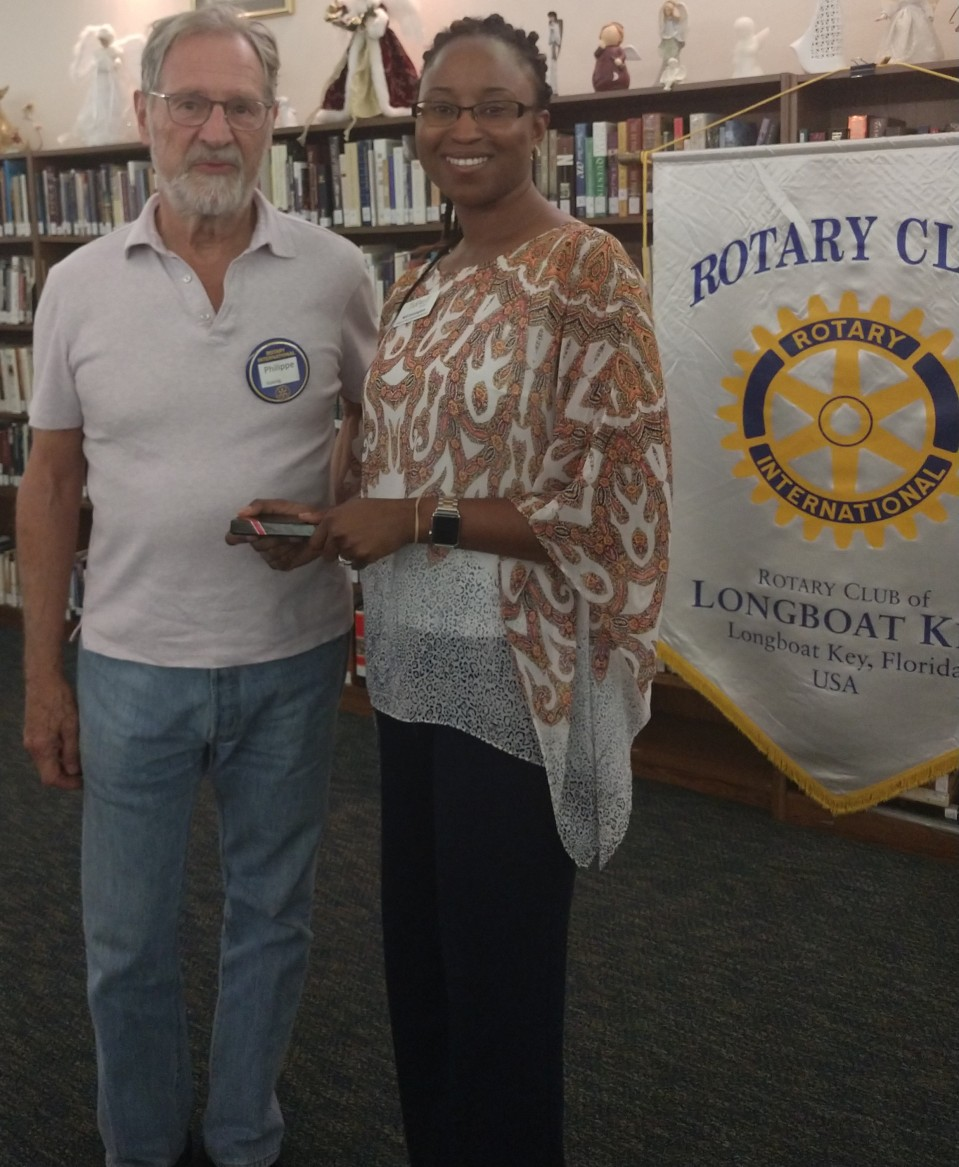 Rotary Club member, Philippe Koenig standing with Nafi Cunningham, Community Relations Representative with Tidewell Hospice